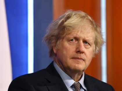 Britain's Prime Minister Boris Johnson gives an update on the coronavirus Covid-19 pandemic during a virtual press conference inside the new Downing Street Briefing Room in central London on March 29, 2021. - England entered the second phase of its lockdown easing on Monday thanks to a successful vaccination drive, …