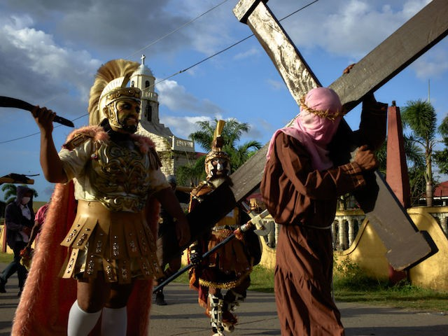 MULANAY PHILIPPINES - MARCH 31: Catholic devotees of the town of Mulanay wear costumes as they reenact the passion of the Christ as part of their annual tradition during holy week, on March 31, 2021 in Mulanay, Philippines. The Philippines, the only predominant Catholic country in Asia, observe the days that led to the crucifixion of Jesus Christ as one of the most important religous days of the year. As with last year, the onset of the Coronavirus pandemic and with the worlds strictest and longest lockdowns, halted most of religous events during this time. The Philippines now stand at the top of the list with the most Covid-19 infection rate in Southeast Asia. (Photo by Jes Aznar/Getty Images)