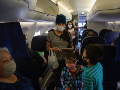 """Reina (C L), Diana (C) and Dariel (R) from El Salvador board a flight on March 30, 2021 from Houston to New York, following their release from a US government holding facility for illegal migrants seeking asylum in McAllen, Texas. - """"Please help me, I don't speak English, """"a manila …"""