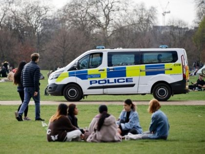 A police van patrols as people relax in Hyde Park in central London on April 2, 2021 as life continues following an easing of the coronavirus restrictions to allow people from more than one household to meet outdoors. (Photo by Tolga Akmen / AFP) (Photo by TOLGA AKMEN/AFP via Getty …
