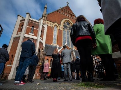 LONDON, ENGLAND - APRIL 04: Christians stand outside during an Easter Sunday service due to lack of space indoors because of covid-19 social distancing guidelines at Christ the King church on April 4, 2021 in the Balham area of London, England. The church had its Good Friday service interrupted by …