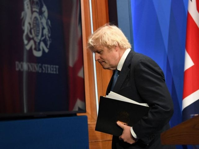 Britain's Prime Minister Boris Johnson leaves after giving an update on the coronavirus Covid-19 pandemic during a virtual press conference inside the new Downing Street Briefing Room in central London on April 5, 2021. - Britain on Monday will unveil plans to restart international travel as it cautiously exits a …