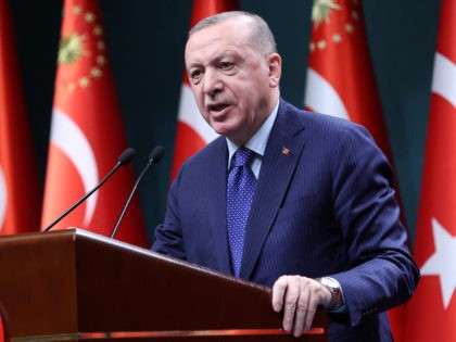 """Turkish President Recep Tayyip Erdogan delivers a speech following an evaluation meeting at the Presidential Complex in Ankara on April 5, 2021. - Erdogan on April 5, 2021, accused dozens of retired admirals of eyeing a """"political coup"""" by attacking his plans for a canal linking the Black Sea to …"""