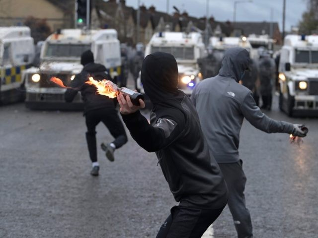 BELFAST, NORTHERN IRELAND - APRIL 08: Nationalists attack Police on Springfield Road just up from Peace Wall interface gates which divide the nationalist and loyalist communities on April 8, 2021 in Belfast, Northern Ireland. Trouble has flared for a second night running in the Springfield Road area of Belfast. US …