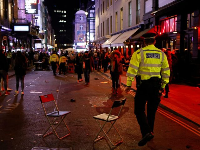 Police officers patrol the streets after a day where customers were able to drink at tables outside the pubs and bars in the Soho area of London, on April 12, 2021 after coronavirus restrictions were eased across the country in step two of the government's roadmap out of England's third …