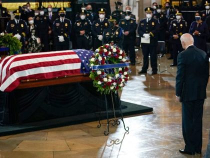 President Joe Biden pauses at the casket of slain US Capitol Police officer William Billy Evans during a ceremony in the Rotunda at the Capitol in Washington, DC on April 13, 2021. - Evans was killed and another wounded after a man rammed through security and crashed into a barrier …