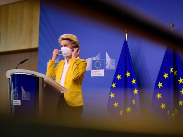 European Commission President Ursula von der Leyen removes her face mask as she arrives for a statement after a college meeting at the EU headquarters in Brussels on April 14, 2021. (Photo by JOHN THYS / POOL / AFP) (Photo by JOHN THYS/POOL/AFP via Getty Images)