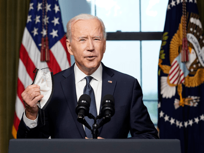 U.S. President Joe Biden holds his face mask as he speaks from the Treaty Room in the White House about the withdrawal of U.S. troops from Afghanistan on April 14, 2021 in Washington, DC. President Biden announced his plans to pull all remaining U.S. troops out of Afghanistan by September …