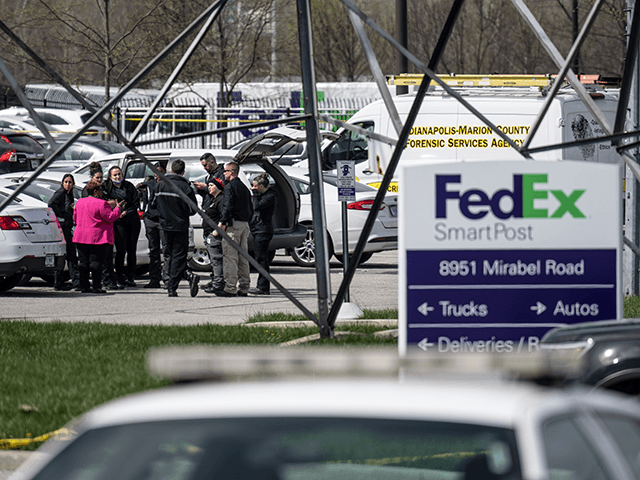 A group of crime scene investigators gather to speak in the parking lot of a FedEx SmartPost on April 16, 2021 in Indianapolis, Indiana. The area is the scene of a mass shooting at FedEx Ground Facility that left at least eight people dead and five wounded on the evening …