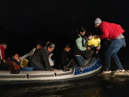 ROMA, TX - APRIL 23: Asylum-seeking migrants' families disembark from an inflatable raft after crossing the Rio Grande river into the United States from Mexico on April 23, 2021 in Roma, Texas. A surge of mostly Central American immigrants crossing into the United States, including record numbers of children, has …
