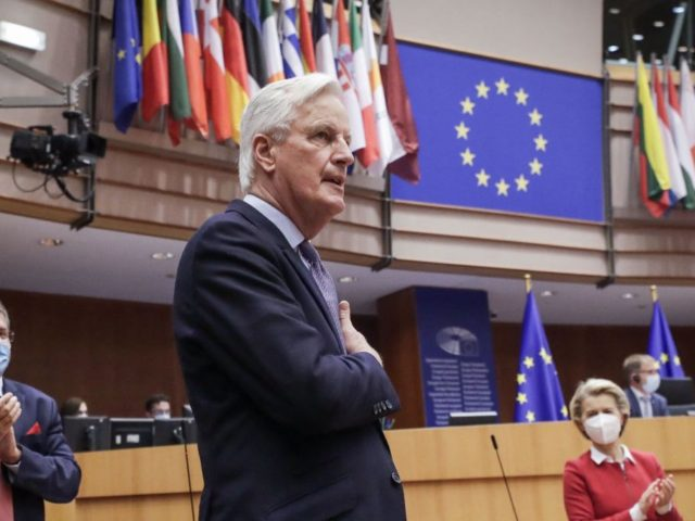 Head of the Task Force for Relations with the UK, Michel Barnier (C), flanked by European Commission President Ursula von der Leyen (R) gestures during the debate on EU-UK trade and cooperation agreement during the second day of a plenary session at the European Parliament in Brussels, on April 27, …