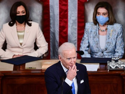 WASHINGTON, DC - APRIL 28: U.S. President Joe Biden addresses a joint session of congress as Vice President Kamala Harris (L) and Speaker of the House U.S. Rep. Nancy Pelosi (D-CA) (R) look on in the House chamber of the U.S. Capitol on April 28, 2021 in Washington, DC. On …