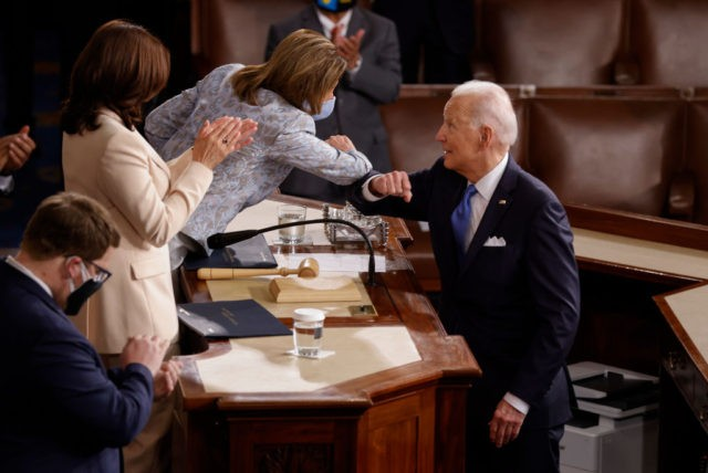 WASHINGTON, DC - APRIL 28: U.S. President Joe Biden elbow bumps Speaker of the House Nancy Pelosi as he greets her and Vice President Kamala Harris after concluding his address to a joint session of the U.S. Congress in the House chamber of the U.S. Capitol April 28, 2021 in …