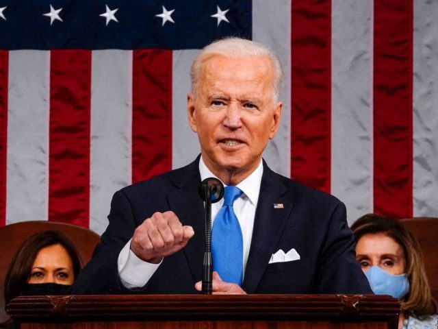 US President Joe Biden, flanked by US Vice President Kamala Harris (L) and Speaker of the House of Representatives Nancy Pelosi (R), addresses a joint session of Congress at the US Capitol in Washington, DC, on April 28, 2021. (Photo by Melina Mara / POOL / AFP) (Photo by MELINA …