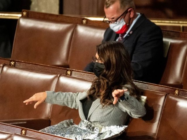 Representative Lauren Boebert (R-CO) spreads what appears to be a Mylar survival blanket on her lap as US President Joe Biden addresses a joint session of Congress at the US Capitol in Washington, DC, on April 28, 2021. (Photo by Caroline Brehman / POOL / AFP) (Photo by CAROLINE BREHMAN/POOL/AFP …