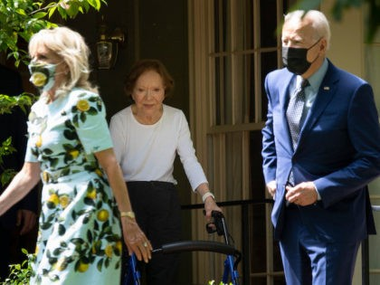 Former First Lady Rosalynn Carter (C) walks US President Joe Biden and US first lady Dr. Jill Biden out after they after visited former US President Jimmy Carter, April 29, 2021, in Plains, Georgia. (Photo by Brendan Smialowski / AFP) (Photo by BRENDAN SMIALOWSKI/AFP via Getty Images)