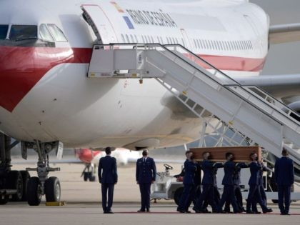 Spanish airforce personnel carry one of the three coffins with the bodies of Spanish journalists David Beriain and Roberto Fraile and Irish ONG chief Rory Young, killed in eastern Burkina Faso, after arriving in the Torrejon de Ardoz air base on April 30, 2021. - David Beriain and Roberto Fraile, …