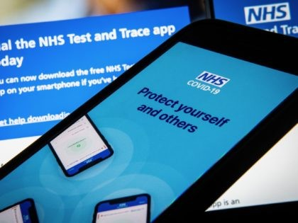 "LONDON, ENGLAND - AUGUST 13: In this photo illustration the official NHS Covid-19 ""Test and Trace"" contact tracing app is seen on a screen on August 13, 2020 in London, England. The NHS has used several mobile applications during the course of the pandemic to help patients assess and report …"