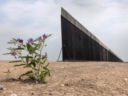 LA JOYA, TEXAS - APRIL 14: A portion of U.S.-Mexico border wall stands unfinished on April 14, 2021 near La Joya, Texas. President Joe Biden paused wall construction by executive order upon taking office in January, 2021. The administration has reportedly decided to possibly finish wall construction on gaps where …