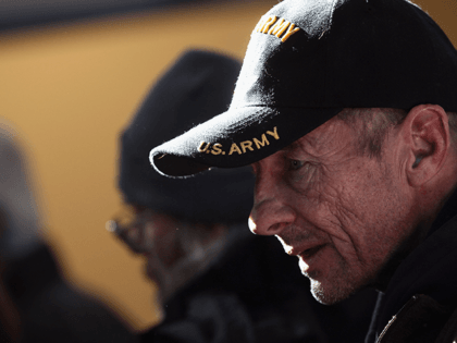 "A homeless U.S. military veteran stands in line for free winter clothing at a ""Stand Down"" event hosted by the Department of Veterans Affairs on November 3, 2011 in Denver, Colorado. A week ahead of Veterans Day, more than 500 homeless veterans were expected to attend the event, where they …"