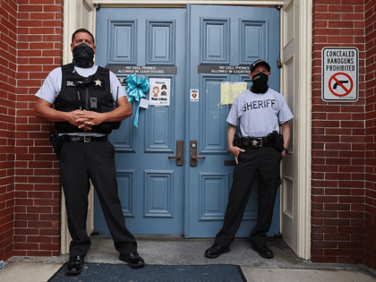 Sheriff Deputies stand in front of the front entrance to the Pasquotank County Courthouse on April 28, 2021 in Elizabeth City, North Carolina. Superior Court Judge Jeff Foster is holding a hearing in the courthouse to decide if the body camera footage will be released of the shooting and killing …