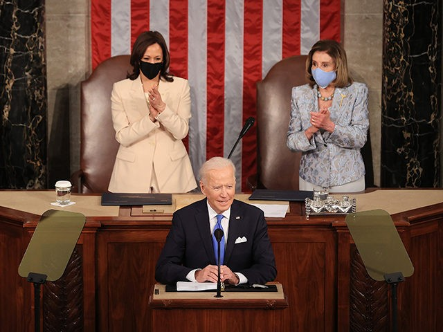 WASHINGTON, DC - APRIL 28: U.S. President Joe Biden addresses a joint session of congress as Vice President Kamala Harris (L) and Speaker of the House U.S. Rep. Nancy Pelosi (D-CA) (R) look on in the House chamber of the U.S. Capitol April 28, 2021 in Washington, DC. On the …