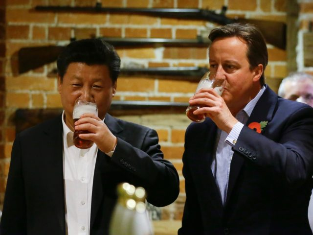 PRINCES RISBOROUGH, ENGLAND - OCTOBER 22: China's President Xi Jinping and Britain's Prime Minister David Cameron drink a pint of beer during a visit to the The Plough pub on October 22, 2015 in Princes Risborough, England. The President of the People's Republic of China, Mr Xi Jinping and his …