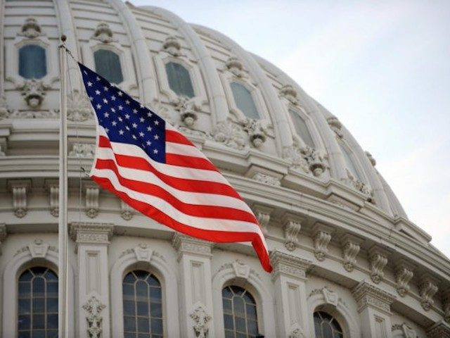 The US flag flies at the US Capitol in Washington, DC, January 20, 2009. Millions of people are expected to be in the US capital to witness the swearing of Barack Obama as 44th President of the United States. AFP PHOTO/Stan HONDA (STAN HONDA/AFP/Getty Images)