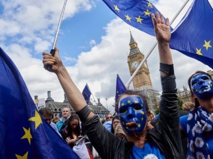 "Pro-EU demonstrators rally during the People's March for Europe against Brexit in Parliament Square in central London on September 9, 2017. - Thousands joined the pro-EU march calling on politicians to ""unite, rethink and reject Brexit"". (Photo by NIKLAS HALLE'N / AFP) (Photo credit should read NIKLAS HALLE'N/AFP via Getty …"
