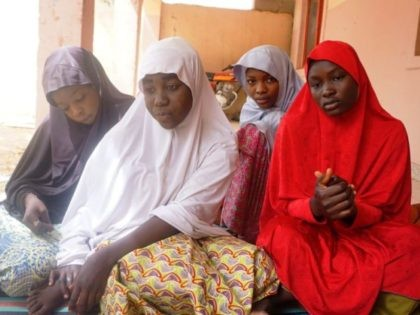 (From left) Fatima Abdu, 14, Zahra Bukar, 13, Fatima Bukar, 13 and Yagana Mustapha, 15, four schoolgirls of Government Girls Technical College, who escaped from Boko Haram attack, sit at home of schoolmate at Dapchi town in northern Nigerian on February 28, 2018. Nigeria's government on March 1 said it …