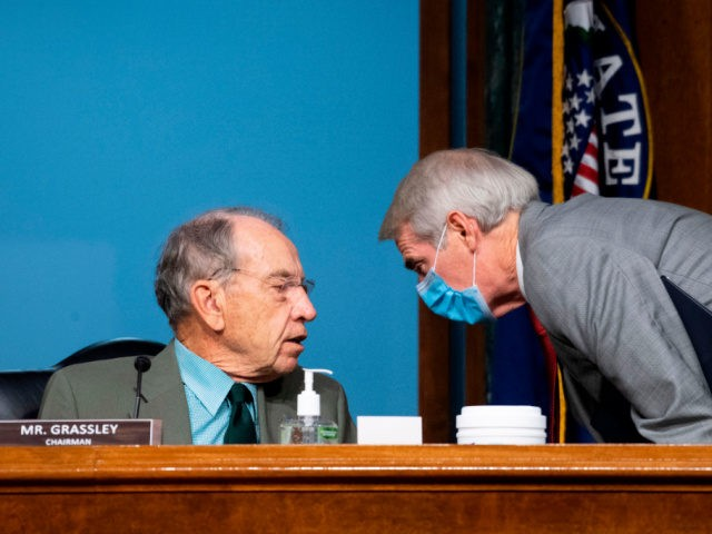 Chairman Chuck Grassley, R-Iowa, left, speaks with Sen. Rob Portman, R-Ohio, during a Senate Finance Committee hearing on COVID-19/Unemployment Insurance on Capitol Hill in Washington on June 9, 2020. (Photo by Caroline Brehman / POOL / AFP) (Photo by CAROLINE BREHMAN/POOL/AFP via Getty Images)