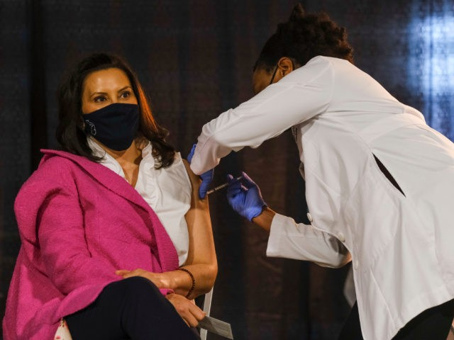 Michigan Governor Gretchen Whitmer receives a dose of the Pfizer Covid vaccine at Ford Field during an event to promote and encourage Michigan residents to get the vaccine on April 6, 2021 in Detroit, Michigan. As the US reaches a milestone in vaccinations, a surge of new Covid-19 cases has …