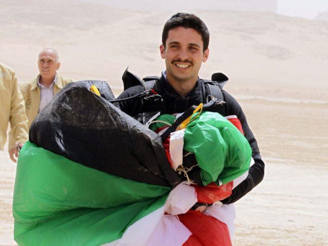 "Jordanian Prince Hamza bin al-Hussein, president of the Royal Aero Sports Club of Jordan, carries a parachute during a media event to announce the launch of ""Skydive Jordan"", in the Wadi Rum desert on April 19, 2011. Skydive Jordan will be held June 8th till June 30th in Wadi Rum. …"