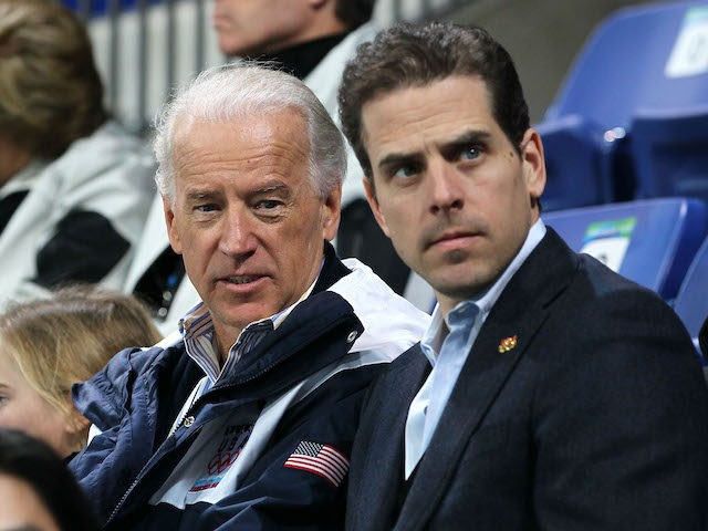 United States vice-president Joe Biden (L) and his son Hunter Biden (R) attend a women's ice hockey preliminary game between United States and China at UBC Thunderbird Arena on February 14, 2010 in Vancouver, Canada. (Bruce Bennett/Getty Images)