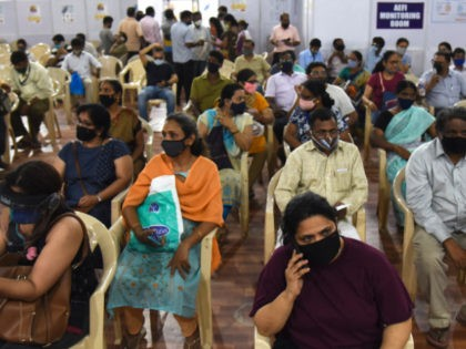 People wait in observation room to receive a dose of the Covishield, AstraZeneca-Oxford's Covid-19 coronavirus vaccine at a vaccination centre during a weekend lockdown imposed by the state government amidst rising Covid-19 coronavirus cases, in Mumbai on April 10, 2021. (Photo by Sujit Jaiswal / AFP) (Photo by SUJIT JAISWAL/AFP …