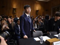 Hong Kong Sentences Anti-Communist Leader Joshua Wong to Prison for Wearing a Mask