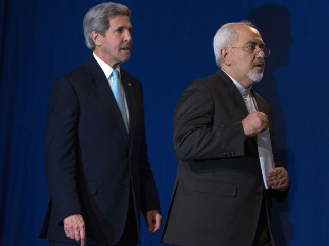 US Secretary of State John Kerry (L) and Iranian Foreign Minister Javad Zarif arrive to deliver a statement at the Swiss Federal Institute of Technology in Lausanne (Ecole Polytechnique Federale De Lausanne) on April 2, 2015, after Iran nuclear program talks finished with extended sessions. European powers and Iran on …