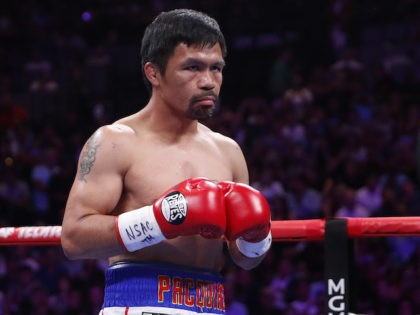 In this Saturday, July 20, 2019 file photo, Manny Pacquiao prepares to fight Keith Thurman in a welterweight title fight in Las Vegas. Qatar is preparing to host the 2022 World Cup and is now looking to attract big-name boxing. Promoter Bob Arum has been in talks with Qatari officials …
