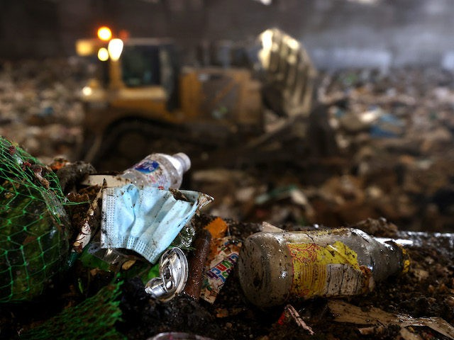 SAN FRANCISCO, CALIFORNIA - APRIL 2: A discarded surgical mask sits on a pile trash in a trash pit at Recology on April 2, 2021 in San Francisco, California. Concerns are growing over discarded COVID-19 related used personal protective equipment (PPE) that is littering streets and waterways since it contains …