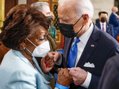 US President Joe Biden fist bumps US Representative Maxine Waters (D-CA) after he concluded his first address to a joint session of the US Congress at the US Capitol in Washington, DC, on April 28, 2021. (Photo by Melina Mara / POOL / AFP)