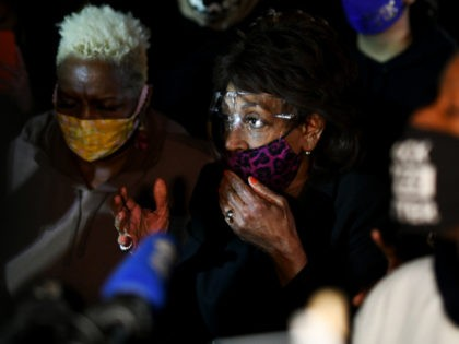 Representative Maxine Waters(C) (D-CA) speaks to the media during an ongoing protest at the Brooklyn Center Police Department in Brooklyn Centre, Minnesota on April 17, 2021. - Police officer, Kim Potter, who shot dead Black 20-year-old Daunte Wright in a Minneapolis suburb after appearing to mistake her gun for her …