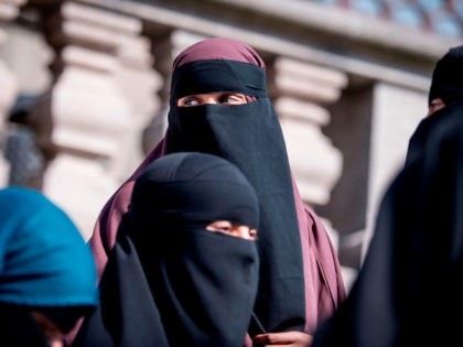 Women wearing niqab exit the Danish Parliament in Copenhagen, Denmark, on May 31, 2018. - The Danish parliament on Thursday, May 31,2018, passed a law banning the Islamic full-face veil in public spaces, becoming the latest European country to do so. (Photo by Mads Claus Rasmussen / Ritzau Scanpix / …