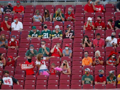 Fans social distance during an NFL football game between the Green Bay Packers and the Tampa Bay Buccaneers Sunday, Oct. 18, 2020, in Tampa, Fla. (Jeff Haynes/AP Images for Panini)