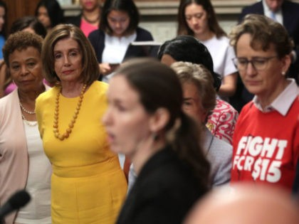 U.S. Speaker of the House Rep. Nancy Pelosi (D-CA) (2nd L) and Rep. Barbara Lee (D-CA) (L) listen during a news conference prior to a vote on the Raise the Wage Act July 18, 2019 at the U.S. Capitol in Washington, DC. The legislation would raise the federal minimum wage …