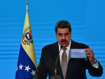 Nicolas Maduro President of Venezuela holds a protective facemask as he speaks in a press conference at Miraflores Palace on February 17, 2021 in Caracas, Venezuela. Nicolas Maduro President of Venezuela announced the country will start vaccinating health workers from Thursday with the Covid-19 Vaccine Sputnik V. (Photo by Carolina …