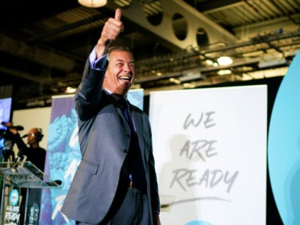 DONCASTER, ENGLAND - SEPTEMBER 04: Leader of the Brexit Party Nigel Farage addresses party members and delegates at Doncaster Racecourse during the Brexit Party Conference tour on September 4, 2019 in Doncaster, England. The rally is part of a nationwide conference tour in which Nigel Farage will address audiences around …