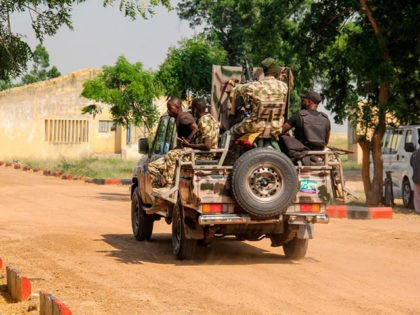 Nigerian Army soldiers are seen driving on a military vehicle in Ngamdu, Nigeria, on November 3, 2020. (Photo by Audu Marte / AFP) (Photo by AUDU MARTE/AFP via Getty Images)