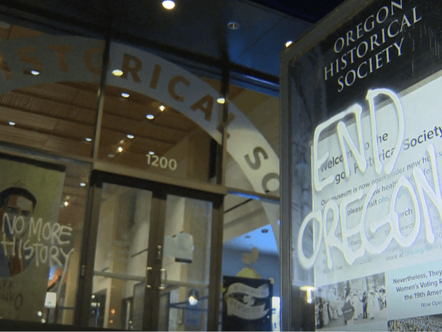 Antifa rioters vandalize the Oregon Historical Society on April 16 marking their second attack by Antifa in less than a year. (KGW NBC8 Video Screenshot)