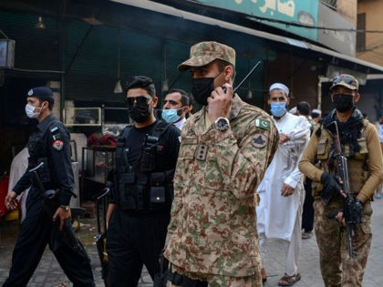 Army soldiers patrol in a market to implement new restrictions imposed as a preventive measure against the spread of the Covid-19 coronavirus in Peshawar on April 26, 2021. (Photo by Abdul MAJEED / AFP) (Photo by ABDUL MAJEED/AFP via Getty Images)