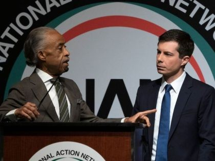 The Reverend Al Sharpton (L) asks a question of Democratic presidential candidate Pete Buttigieg during a gathering of the National Action Network April 4, 2019, in New York. - The National Action Network is a not-for-profit, civil rights organization founded by Sharpton. (Photo by Don EMMERT / AFP)